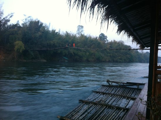 Boutique Raft Resort: early in the morning, i saw a monk crossing the bridge