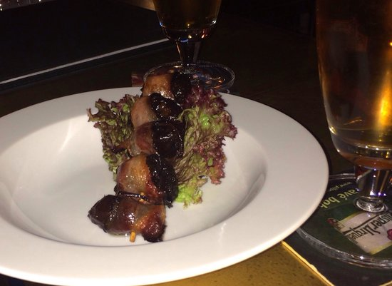 Charleston: Bacon wrapped fried plums.