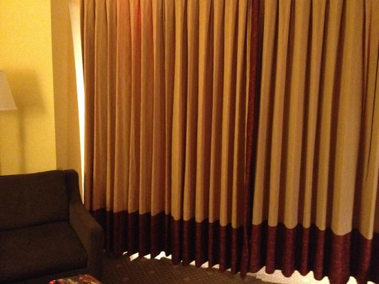 Hotel Commonwealth: Jr. Suite - Curtain separating bedroom from sitting area