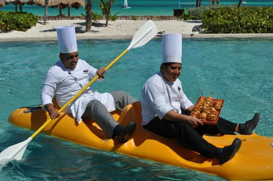 Secrets Maroma Beach Riviera Cancun: Snacks delivered by kayak in the pool -- impressive!