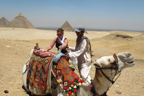 Ayman Ahmed - Tour Guide: Visit to Giza. A camel ride and tea with Bedouins arranged by Ayman.