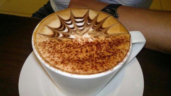 Coco Cafe: Sample of cappuccino art.