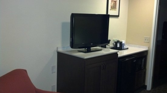 Holiday Inn Express Hotel and Suites Scottsdale - Old Town: living room television, fridge and micro