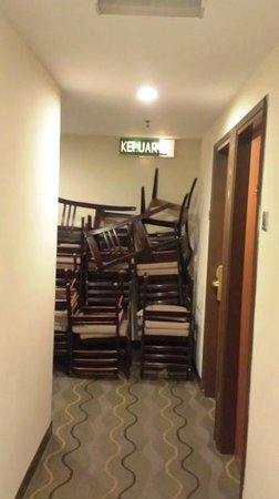 Hallmark Hotel: Chairs stacked in passageway obstructing emergency exit
