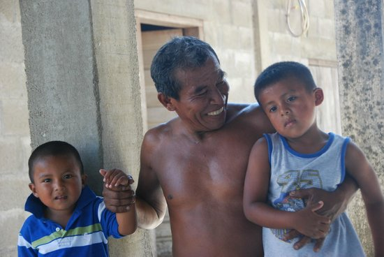 Cotton Tree Lodge: Eladio beaming with pride with his youngest son and one of his grandsons