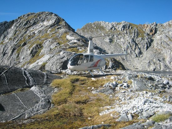 Southern Lakes Helicopters: Southern Lakes helicopter at mountain top landing