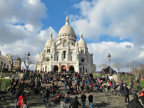 Basilique du Sacré-Cœur de Montmartre : The sacre -coeur bathing in the early march sun.The stairwayss ful of local youngsters.