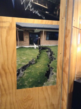 Quake City: Photographing the photo on display of the earth opening up in a resident's garden