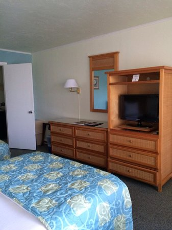 Outrigger Beach Resort: Dresser and tv in Standard Guest room