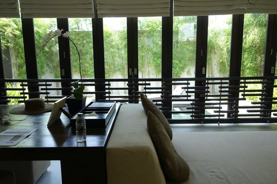 eqUILIBRIA SEMINYAK: view of pool and waterfall from living room