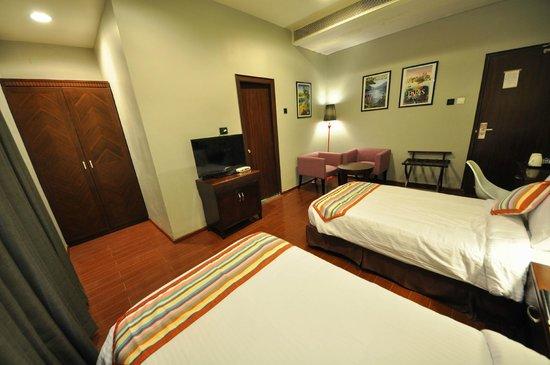 The Travotel Suites Photo