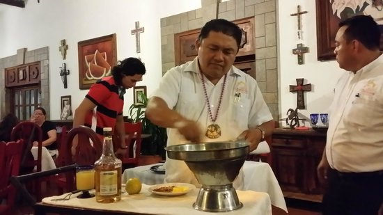 Casa Mission: Jose' preparing bananas flambe'.