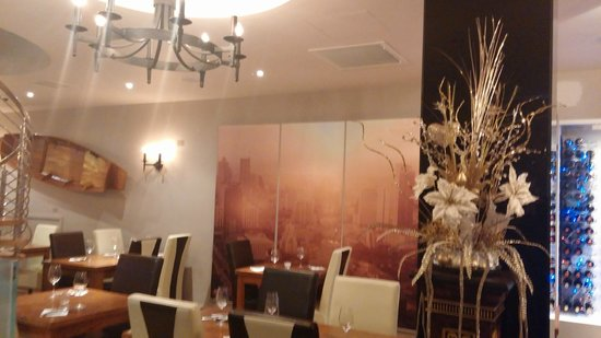 Carabao Thai Restaurant and Steak House: The restaurant with a scenic picture of Bangkok