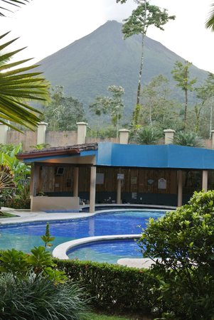 Hotel Magic Mountain: View of pool and Arenal volcano from 108