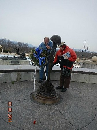 National D-Day Memorial: re-setting the wreath knocked down by wind