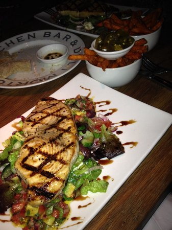 Mortons Kitchen Bar and Deli: Swordfish on a bed of Greek salad with sweet potato fries and some cheeky jalapeños ... Lush ��?