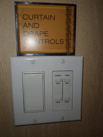Caesars Palace: wall remote for curtains/ drapes... Awesomely lazy