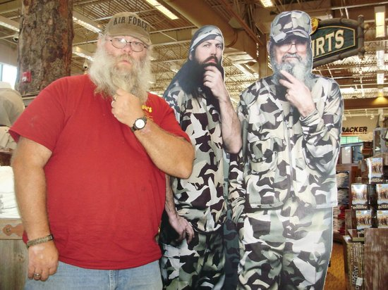 Comfort Suites Kodak: Posing with a couple of the Duck Dynasty guys cardboard standup in the Sevierville Bass Pro Shop