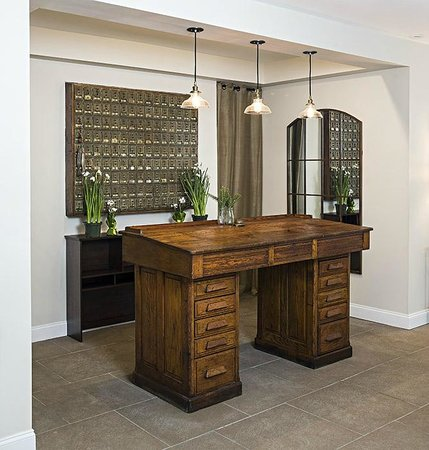 506 On The River Inn : The Reception is an antique architects drafting table.