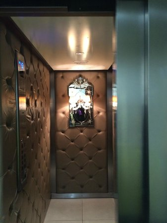 The Beacon: Ornate lighting and leather walls in the hotel lift