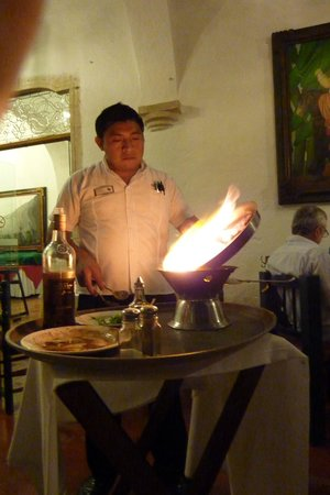 El Meson del Marques: the waiter/cook flaming the food in front of us