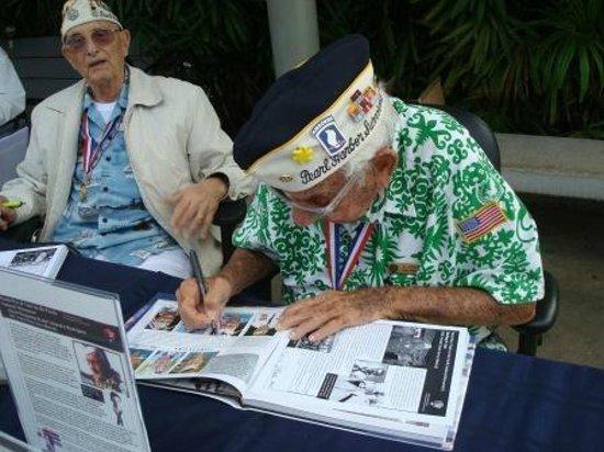 USS Arizona Memorial/WW II Valor in the Pacific National Monument : Pearl Harbor Survivor signing their pictures - USS Arizona Memorial, Honolulu, Oahu, HI