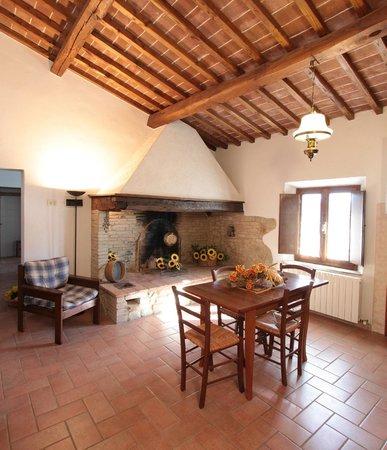 Agriturismo Montegonfoli: Montegonfoli Six fireplace and living room
