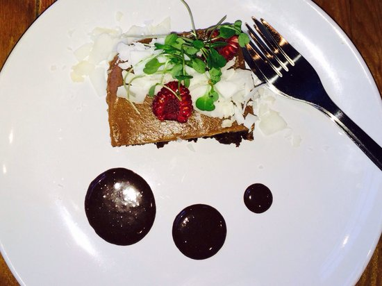 Living Kitchen: Raw brownie with Carmel sea salt topping. All topped with shaved coconut  ....I loved this desse