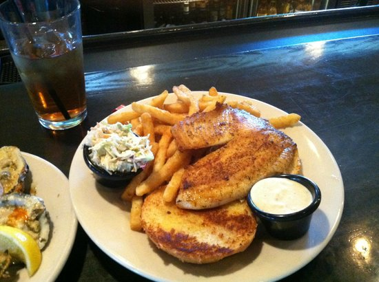 Shuckers Oyster Bar & Grill: Tremendous Tilapia, super slaw, fantastic fries & remarkable Remoulade