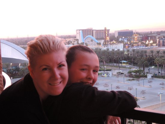 Sheraton Park Hotel at the Anaheim Resort : Me and our son on the balcony overlooking the back of Disney's California Park
