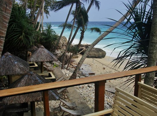 "Freddies Santai Sumurtiga: View from the deck of the ""á la carte restaurant"" - beach chairs and sandy beach below."