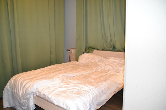 "MEININGER Hotel Amsterdam City West : ""given as an adapted room"" There is no room to walk around the bed or to even close your curtain"