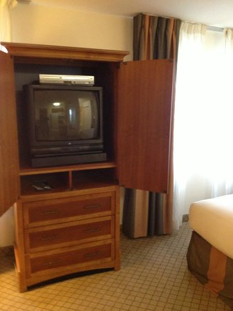 Sonesta ES Suites Houston: The TV in a cabinet.