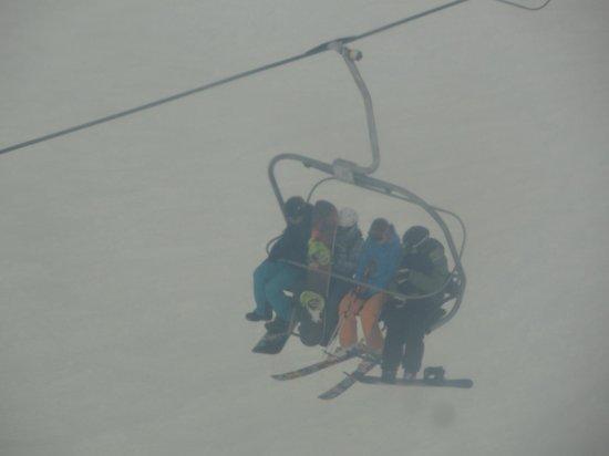 Skiiers Reaching Aparwat Through Chair Lift Picture Of