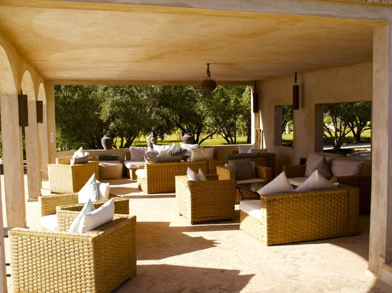 The Capaldi : Seating area by one of the pools