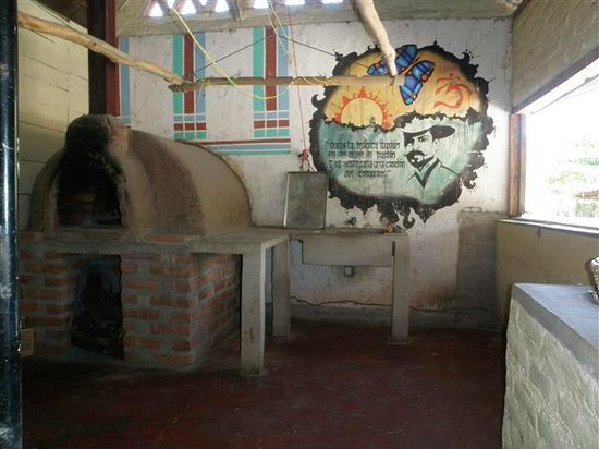 Cafe Campestre: pizza oven and mural in part of the kitchen