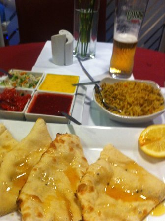 Panacea Premier Indian Dining: Super fresh peshwari naan, and complimentary relishes.