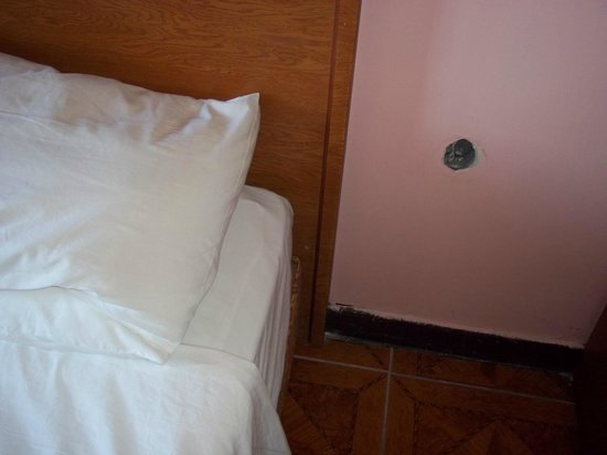 Hali Hotel: hole in the wall with electrical wires