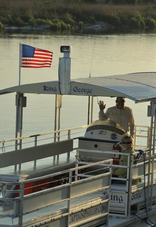 Darien River Wine and ECO Cruise: Captain Phillip at helm of King George