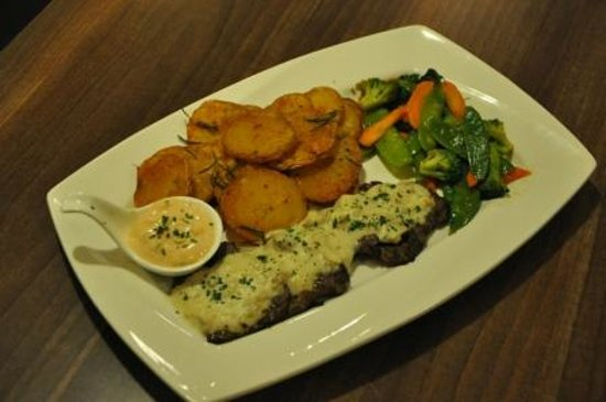 Urban Grind Coffee & Grill: Peppercorn Steak with fresh vegetables and our Signature Urban Grind potatoes