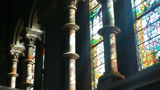 St Fin Barre's Cathedral: Sunrays getting in through the astonishing stained glass.