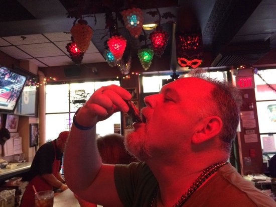 Acme Oyster House: Murray eating a raw oyster.
