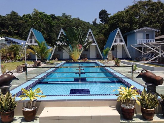 Nipah Guesthouse: View of pool and A-Frame Cottages.