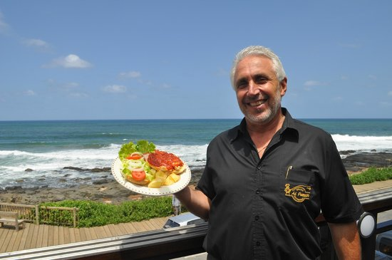Al Pescatore : The owner Trevor with the breathtaking sea veiws.
