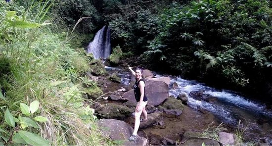 Arenal Observatory Lodge & Spa: Tori at the waterfall on the property