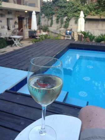 Shulamit Yard: Glass of local wine by the pool