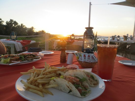 Mango Reef: Fish taco and rum punch at sunset