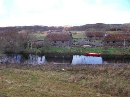 Clan Cottages: View from opposite bank of river