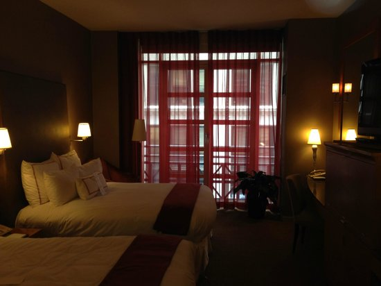 Hotel Giraffe by Library Hotel Collection: room when we first walk in-not all lights are on, shows dark