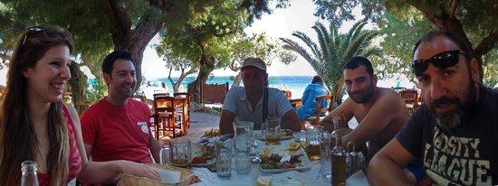 Damnoni Taverna: Under the trees..